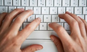 Hands Writing On Keyboard